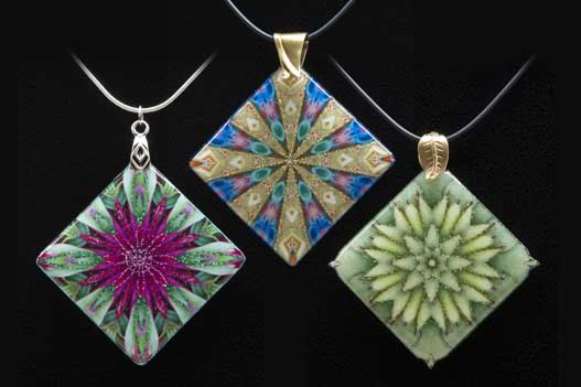 The kaleidoscopes for these pendants were printed on fabric, then covered with clear epoxy resin.